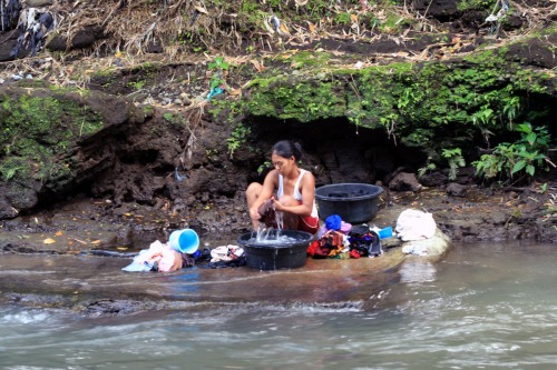 traditional washing clothes on the river of Winanga